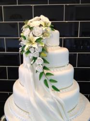 4 tier with cascading flowers