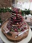 Naked wedding cake with fresh fruit ..