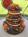 Naked wedding cake with fruit and berries .