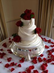 Three tier with fresh roses