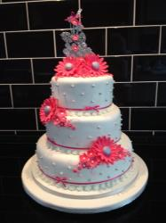 Three tier with pink Gerberas